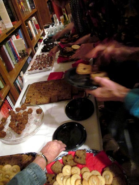 The dessert table loaded with platters of seed cake, vegan chocolate cake, orange blossom cookies and multifaith sweetness and light sugarplums.