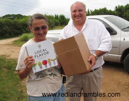 Margie Pikarsky and Charles LaPradd with the new Local Flavors cookbook.