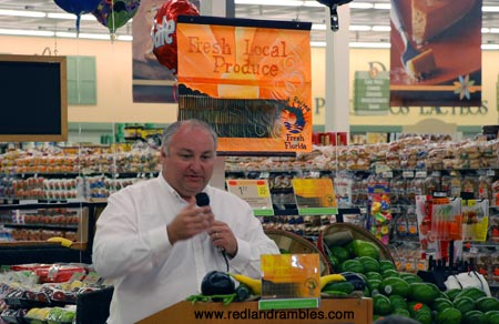 Surrounded by a bounty of local, Redland produce, Charles LaPradd speaks at the launch in 2009.