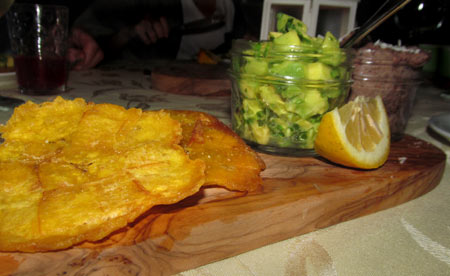 Tostones with chunky guacamole and black bean spread.