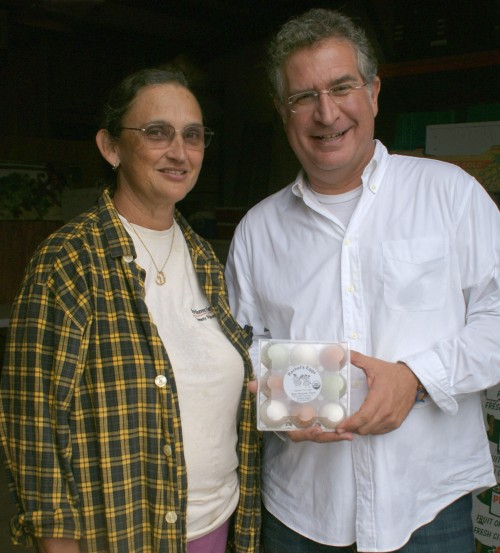 Farmer Margie Pikarsky and Congressman Joe Garcia, with a package of Rachel's Eggs. Photo by Nicole Fiori.