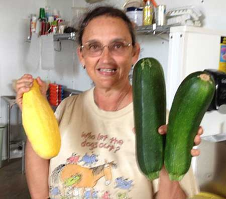 Farmer Margie with giant squash.