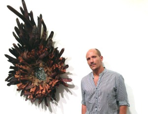 John DeFaro with Who is Nest wall assemblage 63rd All FL Juried Competition and Exhibition Boca Raton Museum of Art 2014